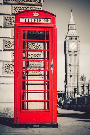 Londons iconic telephone booth with the Big Ben clock tower in the background