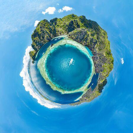 Epic little planet panorama of blue lagoons and limestone cliffs of Coron, Palawan, Philippines.