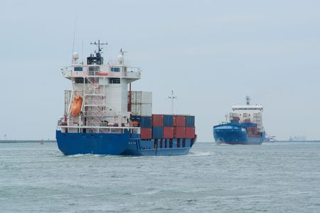 eachother: Two container ships are traveling towards eachother