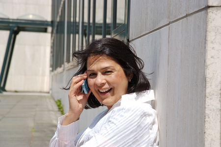 phonecall: Businesswoman outside, making a phonecall