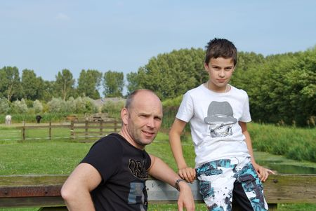 A father and son spending time together, both looking into the camera. photo