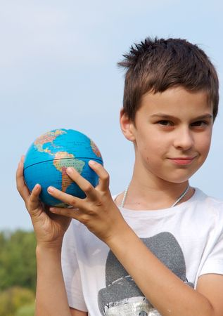 A young boy is holding the world in his hands photo