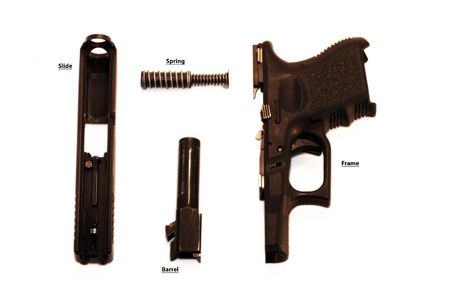 caliber: Disassembled pistol Stock Photo