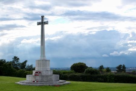 War memorial on hill top overlooking town