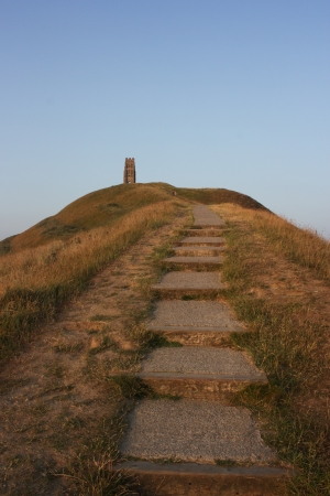 two and two thirds: Two thirds of the way up Glastonbury Tor and heading for St Michaels Tower. All that remains of the 14th century chapel. Stock Photo