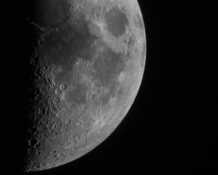 blackness: Detailed and impactfull quadrant of The Moon against the blackness of space Stock Photo
