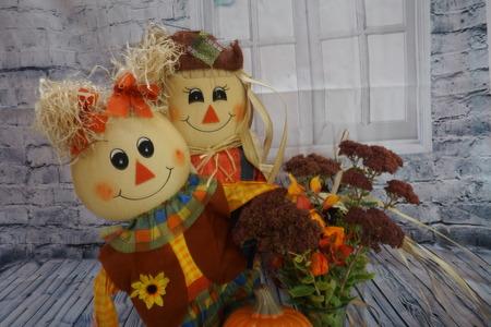 Happy scarecrow couple for halloween.