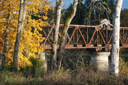 Beautiful Fall Scene of Railroad Trestle and  old mail drop house