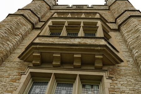 Looking up the side of old, stone building, strong architecture