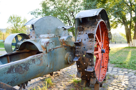 old spiked red iron wheel from the tractor Stock Photo