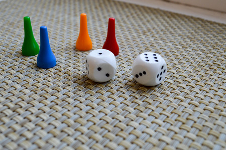 White dice, dice and four chips for board games.