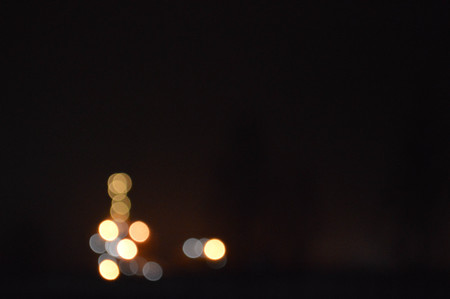 Night photo with the effect of a bokeh oil refinery, a petrochemical plant.