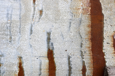 Texture of gray old shabby oxidized metal, iron with rusty stripes and patterns, background.