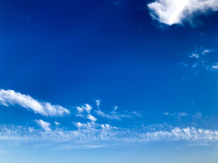 Texture of a gently blue beautiful smoky clear sky with fluffy white air clouds