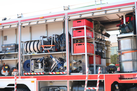 Large special red with blue fire car, engine to rescue people with open sides and extinguishing equipment, fire pump, blowing agent, tool, water sleeves, hoses, baloons, equipment
