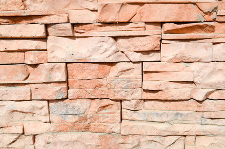 The texture of the wall from the decorative artificial stone tiles is carved brick sharp. The background. 스톡 콘텐츠