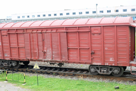 Red brown metal iron freight cars for the train at the railway station.