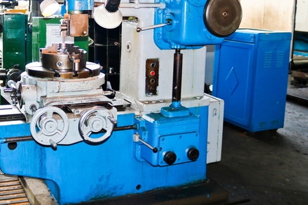 Industrial iron lathe for cutting, turning of billets from metals, wood and other materials, turning, manufacturing of details and spare parts at the factory.