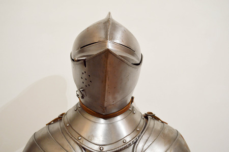 Medieval strong knight warrior chained in iron silvery strong metal armor with a helmet and a visor. Stockfoto