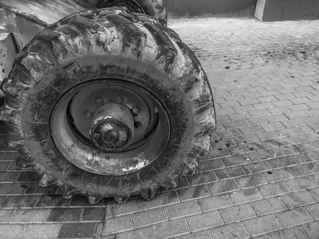 Powerful big wheels with tread and tires of off-road construction equipment, tractors, cars.