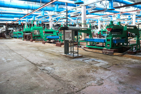 Beautiful metal industrial equipment of a production line at a machine-building plant, a conveyor with machine tools for products. Equipment refinery, petrochemical, chemical plant. Stock Photo