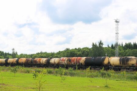 A large railway train with many tank cars carries goods by rail. Rail transportation of liquid cargo. Stock fotó