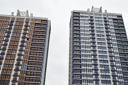 New modern tall blue glass multi-storey comfortable urban monolithic frame houses buildings skyscrapers new buildings in the big city of the megalopolis.