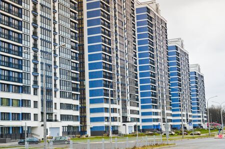 New modern tall blue glass multi-storey comfortable urban monolithic frame houses buildings skyscrapers new buildings in the big city of the megalopolis. Stock Photo