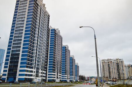 New modern tall blue glass multi-storey comfortable urban monolithic frame houses buildings skyscrapers new buildings in the big city of the megalopolis. 版權商用圖片