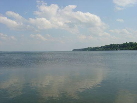 seneca: Seneca lake in the fingerlakes, geneva ny reflecting the clouds and blue sky Stock Photo