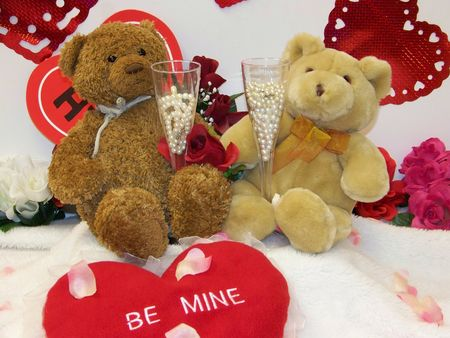 Valentines days teddy bears with champagne glasses hearts and flowers photo