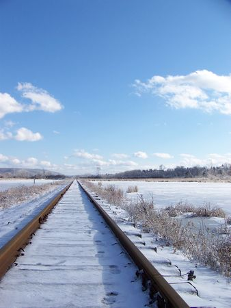 railway transportation: erspective shot, railroad tracks in the snow into the distance, march 2008 Horseheads, NY