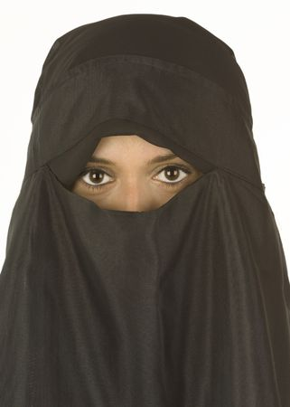 A beautiful middle eastern woman in a traditional niqab veil