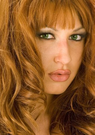 A beautiful redheaded woman pouting seductively