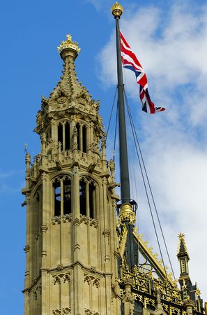 A detail of the gothic architecture of the Victoria Tower of the Houses of Parliament, London, England