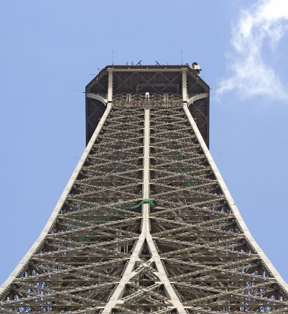 fraternity: An upward looking view of the top part of the Eiffel Tower in Paris, France