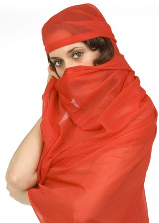 A beautiful brunette in a red shawl covering up her face against a white background