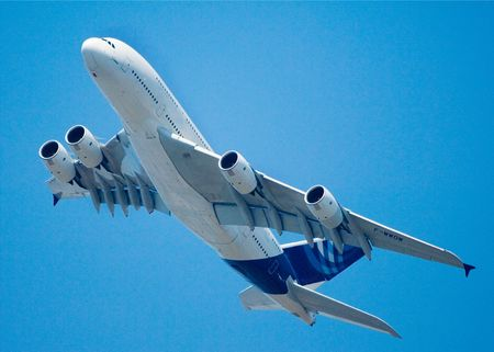 A380 Airbus Super Jumbo airliner banking and flying overhead Stock Photo