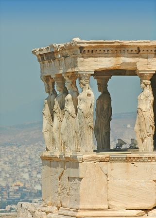 Caryatids at the Acropolis and the city of Athens, Greece in the background