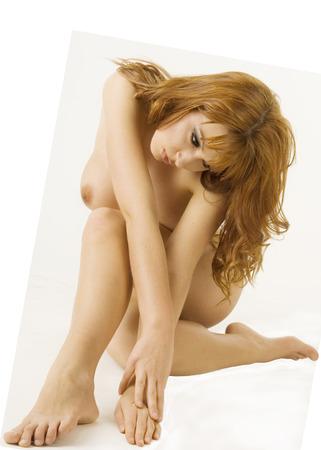 Beautiful nude redheaded woman in classical nude pose Stock Photo - 1511532