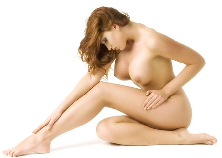 Beautiful redheaded nude woman in classical nude pose against a white background Stock Photo - 2339804