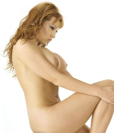 girl boobs: Beautiful redheaded nude woman in classical nude pose against a white background