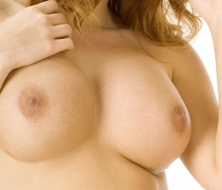 Beautiful redheaded nude woman's breasts Stock Photo - 2368174