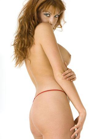 tieten: Mooie rooie topless vrouw tegen een witte achtergrond