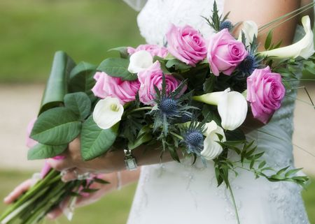 A Bride holding her beautiful flower arrangement at a wedding