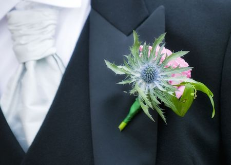 Beautiful Scottish thistle Groom buttonhole at a wedding