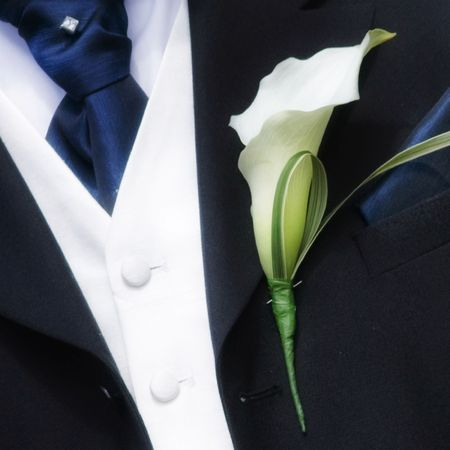 Beautiful lily Groom buttonhole at a wedding Stock Photo