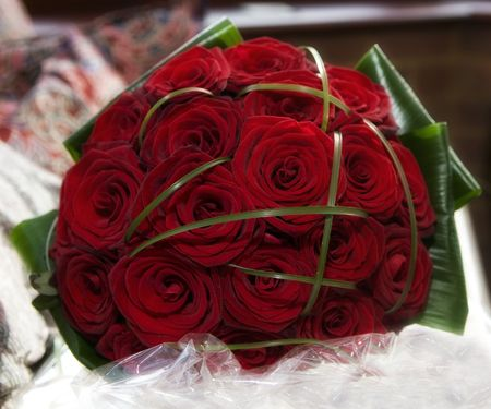 Beautiful wedding bridal bouquet of red roses Stock Photo