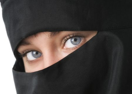 Beautiful blue eyed woman in Middle Eastern veil photo
