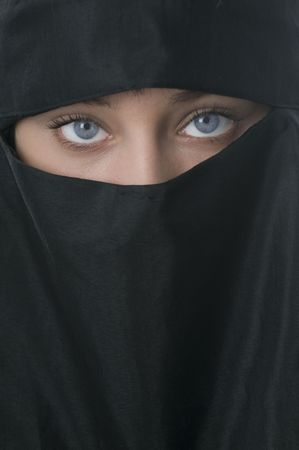 Beautiful blue eyed woman in Middle Eastern veil